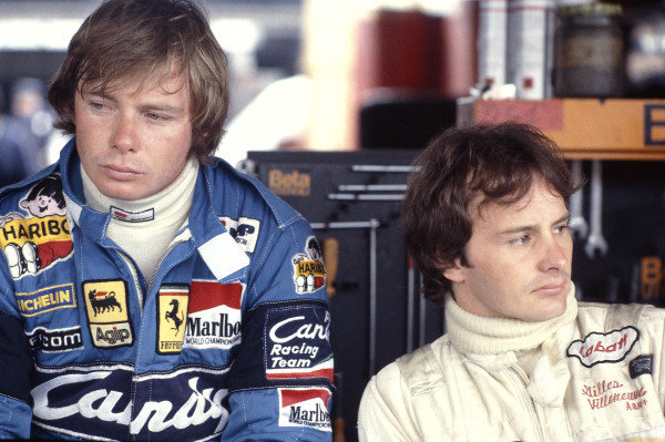 1981 Formula One World Championship.Ferrari team mates Didier Pironi and Gilles Villeneuve in the pit garage together.Ref-V2A 08.World Copyright - LAT Photographic