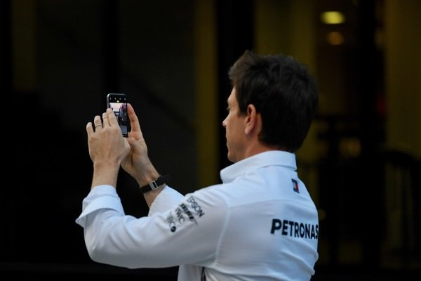 Toto Wolff, Executive Director (Business), Mercedes AMG takes a photograph of the paddock on his phone