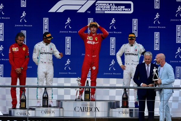 Laurent Mekies, Sporting Director, Ferrari, Lewis Hamilton, Mercedes AMG F1, 2nd position, Charles Leclerc, Ferrari, 1st position, and Valtteri Bottas, Mercedes AMG F1, 3rd position, on the podium