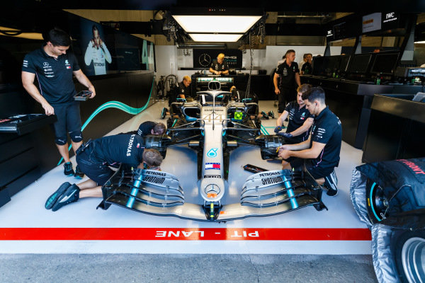 Mechanics work on the car of Lewis Hamilton, Mercedes AMG F1 W10