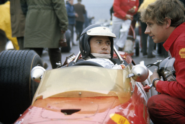 Jim Clark talks to mechanic Dave Sims as he sits in his Gold Leaf Formula 2 Lotus 48 Cosworth on the grid before the start. Clark was killed in the first heat