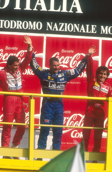 1991 Italian Grand Prix.Monza, Italy.6-8 September 1991.Nigel Mansell (Williams Renault) celebrates 1st position with his two great rivals Ayrton Senna (McLaren Honda) 2nd position and Alain Prost (Ferrari) 3rd position on the podium.Ref-91 ITA 05.World Copyright - LAT Photographic