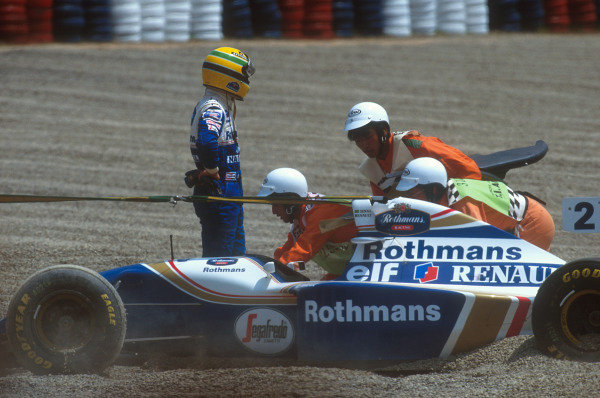 Tanaka International, Aida, Japan.15-17 April 1994.Ayrton Senna (Williams FW16 Renault) reflects after ending up in the gravel at the first corner, after being helped into a spin by Hakkinen and collecting Larini.Ref-94 PAC 05.World Copyright - LAT Photographic