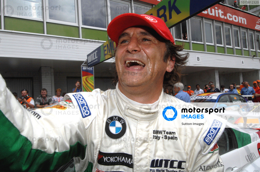 Race one winner Alex Zanardi (ITA) BMW Team Italy-Spain celebrates victory in parc ferme.