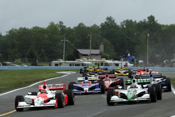 2 - 4 June, 2006, Watkins Glen, New York, USA, Helio Castroneves and Tony Kanaan lead the field through the last turn to the green flag,© 2006 Dan Streck/USA, LAT Photographic