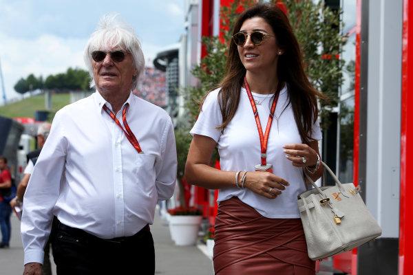 Red Bull Ring, Spielberg, Austria. Sunday 9 July 2017. Bernie Ecclestone, Chairman Emiritus of Formula 1, with his wife. World Copyright: Charles Coates/LAT Images ref: Digital Image DJ5R6858
