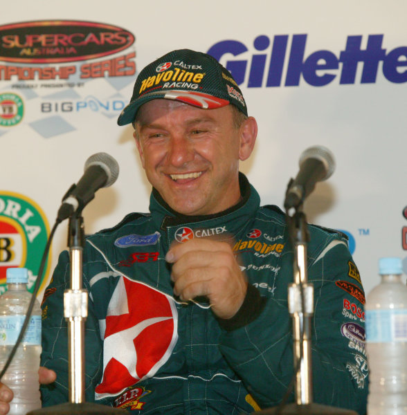 2003 Australian V8 SupercarsSurfers Paradise, Australia. October 25th 2003. Russell Ingall celebrates his victory at the Gillette V8 Supercar event at the Lexmark Indy 300 at the Sufer's Paradise street circuit.World Copyright: Mark Horsburgh/LAT Photographicref: Digital Image Only
