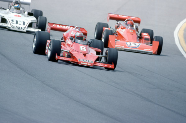 1976 USAC Indycar Series.Pocono, PA, USA. 27th June 1976.Mario Andretti (McLaren-Offenhauser) leads AJ Foyt (Coyote-Ford/Foyt) and Johnny Parsons jr (Eagle-Offenhauser).World Copyright: Murenbeeld/LAT Photographic