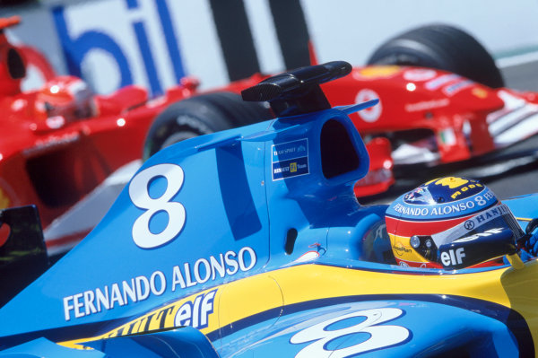 2004 French Grand PrixMagny-Cours, France. 2nd - 4th JulyFernando Alonso, Renault R24 and Michael Schumacher, Ferrari F2004 wait for the start of the race on the grid. Action. World Copyright: LAT PhotographicRef:35mm Image A05