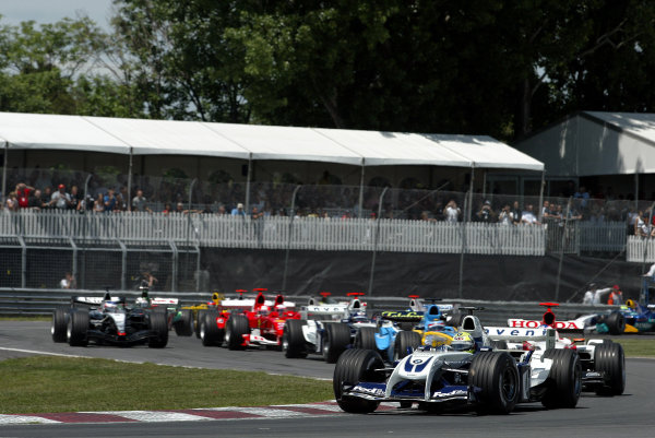 2004 Canadian Grand Prix - Sunday Race,2004 Canadian Grand Prix Montreal, Canada. 13th June 2004 Ralf Schumacher, BMW Williams FW26, leads the pack at the start of the race. Action.World Copyright: Steve Etherington/LAT Photographic ref: Digital Image Only