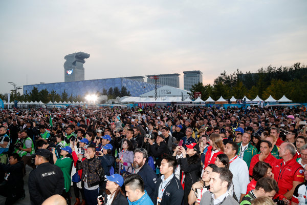 FIA Formula E Championship 2015/16. Beijing ePrix, Beijing, China. Race. Crowd formation at the podium. Beijing, China, Asia. Saturday 24 October 2015 Photo: Adam Warner / LAT / FE ref: Digital Image _L5R2612
