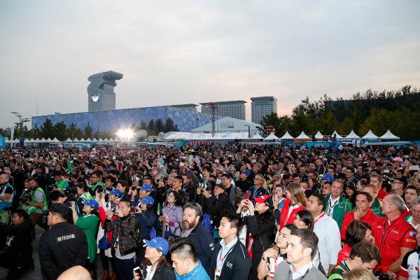 FIA Formula E Championship 2015/16. Beijing ePrix, Beijing, China. Race. Crowd formation at the podium. Beijing, China, Asia. Saturday 24 October 2015 Photo: Adam Warner / LAT / FE ref: Digital Image _L5R2612