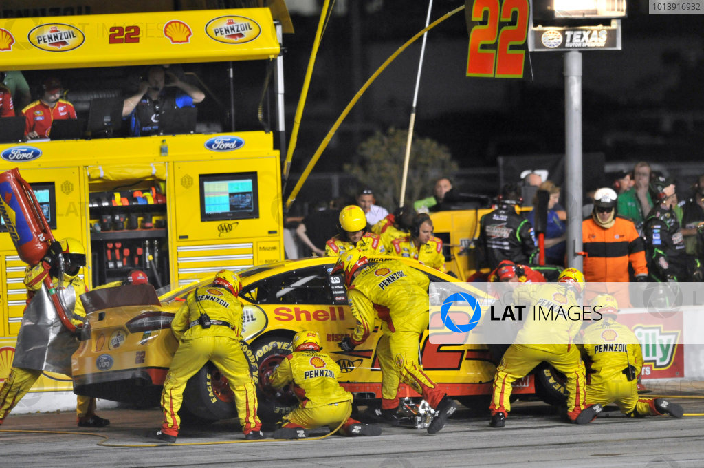 11-13 April, 2013, Fort Worth, Texas USA Joey Logano pit stop ©2013, Nigel Kinrade LAT Photo USA