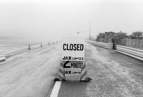 In terrible conditions before the start of the race, a sign appears at the pit lane exit saying the circuit is closed.Japanese Grand Prix, Rd 16, Fuji, Japan, 24 October 1976.