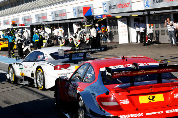 2014 DTM Championship Round 10 - Hockenheim, Germany 17th - 19th October 2014 Nico M?ller (SUI) Audi Sport Team Rosberg Audi RS 5 DTM and Vitaly Petrov (RUS) Mercedes AMG DTM-Team M?cke DTM Mercedes AMG C-Coup? in pitlane World Copyright: XPB Images / LAT Photographic  ref: Digital Image 3354450_HiRes