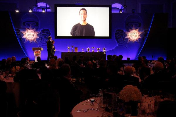 2014 BRDC Annual Awards The Grand Connaught Rooms, London, UK Monday 8 December 2014. Daniel Ricciardo accepts his Innes Ireland Trophy from the big screen. World Copyright: Ebrey/LAT Photographic. ref: Digital Image Ricciardo-01
