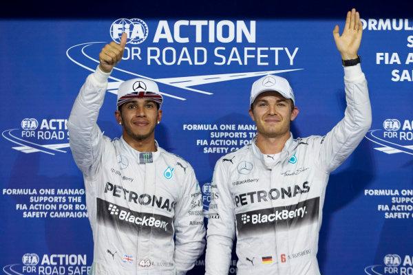 Yas Marina Circuit, Abu Dhabi, United Arab Emirates. Saturday 22 November 2014. Front row starters, pole man Nico Rosberg, Mercedes AMG, and Lewis Hamilton, Mercedes AMG. World Copyright: Steve Etherington/LAT Photographic. ref: Digital Image SNE12356
