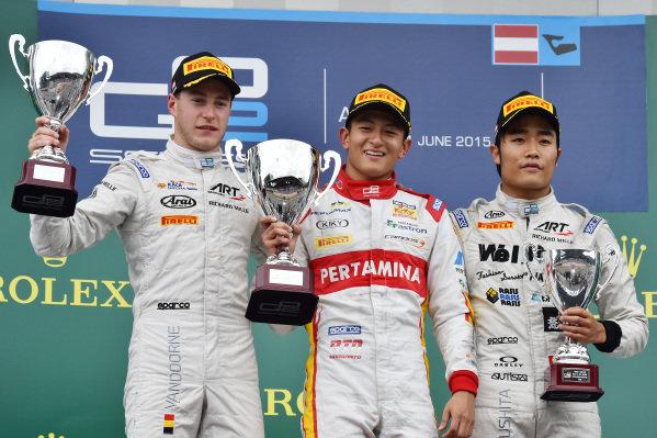 Race 2 podium (L to R): Second placed Stoffel Vandoorne (BEL) ART Grand Prix, race winner Rio Haryanto (INA) Trident and third placed Nobuharu Matsushita (JPN) ART Grand Prix celebrate on the podium with their trophies at GP2 Series, Rd4, Spielberg, Austria, 19-21 June 2015.