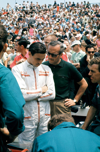 Indianapolis, Indiana, USA.  31st May 1965. Colin Chapman chats with his driver Jim Clark. World Copyright - Dave Friedman/LAT Photographic. Ref: Digital File Only