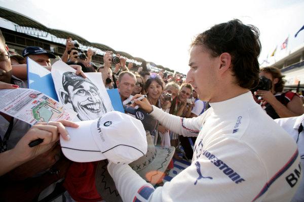 Hungaroring, Budapest, Hungary31st July 2008Robert Kubica, BMW Sauber F1 08 signs autographs for his fans. Portrait.World Copyright: Charles Coates/LAT Photographicref: Digital Image _K5Y3424