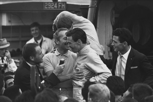 Monza, Italy. 6th - 8th September 1963.  Jim Clark (Lotus 25 Climax), 1st position with team boss Colin Chapman as they celebrate finishing in 1st position and clinching the drivers and constructors World Championship titles, portrait. World Copyright: LAT Photographic. Ref: L63 - 282 - 37.
