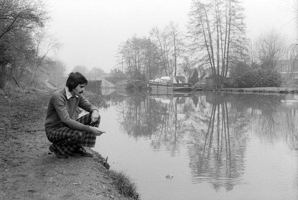 Gordon Murray (RSA) Brabham Designer relaxes by a canal near the Brabham headquarters. Formula One World Championship, Brabham MRD Headquarters, Chessington, England, 1974.