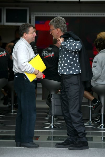 (L to R): Jean Todt (FRA) Ferrari General Manager and Eddie Jordan (IRE) Jordan Team Principal as they leave the team managers meeting, held in the McLaren motorhome.Formula One World Championship, Rd4, San Marino Grand Prix, Preparations, Imola, Italy, 17 April 2003.DIGITAL IMAGE