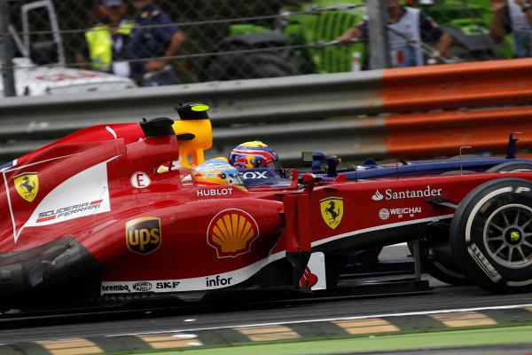 Fernando Alonso (ESP) Ferrari F138 and Mark Webber (AUS) Red Bull Racing RB9 battle. Formula One World Championship, Rd12, Italian Grand Prix, Race, Monza, Italy, Sunday 8 September 2013.