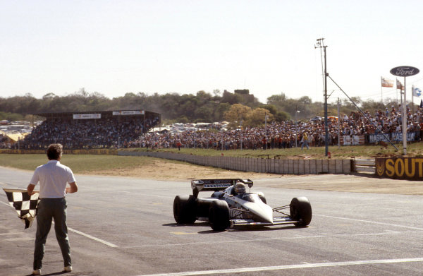 Kyalami, South Africa.13-15 October 1983.Riccardo Patrese (Brabham BT52B-BMW), !st position, takes the chequered flag, action.World Copyright: LAT Photographic.Ref: 83 SA 16.