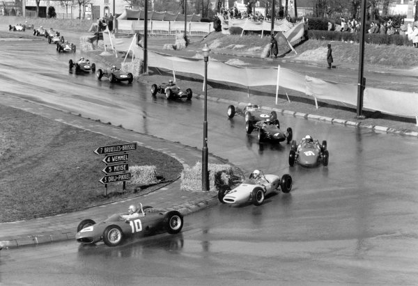 1962 Brussels Grand Prix.Heysel, Brussels (Bruxelles), Belgium. 1 April 1962.Willy Mairesse (Ferrari Dino 156) leads Masten Gregory (Lotus 18-Climax), Jo Bonnier (Porsche 718), John Surtees (Lola Mk4-Climax), Trevor Taylor (Lotus 21-Climax), Roy Salvadori (Cooper T56-Climax), Keith Greene (Gilby-Climax), John Campbell-Jones (Emeryson-Climax) and Ian Burgess (Cooper T53-Climax) at the start.World Copyright: LAT PhotographicRef: Autosport b&w print
