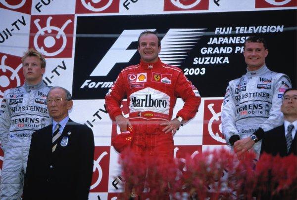 2003 Japanese Grand PrixSuzuka, Japan. 10th - 112th October 2003.Race winner Rubens Barrichello, Ferrari F2003 GA, (1st), Kimi Raikkonen, Team McLaren Mercedes MP4-17D, (2nd) and David Coulthard, (3rd), podium.World Copyright: Lorenzo Bellanca / LAT Photographic ref: 35mm Image 03JAP26