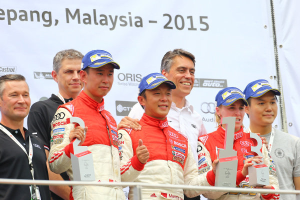 (L to R): Franky Cheng (CHN) FAW-VW Audi Racing Team , Marchy Lee (HKG) Audi Hong Kong Team and Rahel Frey (SUI) Castrol Racing Team on the podium of race 2 at Audi R8 LMS Cup, Rd4, Sepang, Malaysia, 4-6 September 2015.