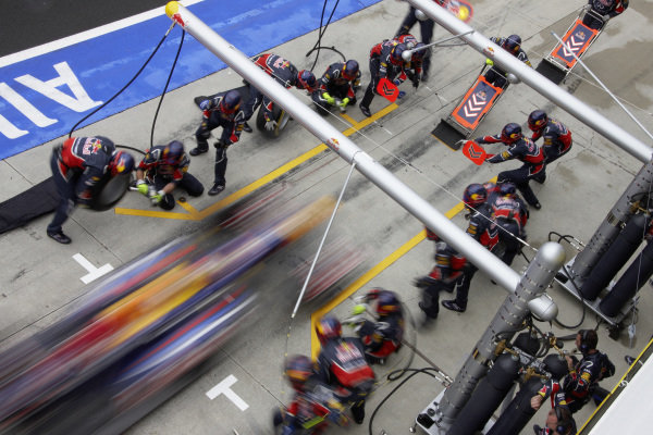 Sebastian Vettel, Red Bull RB7 Renault, makes a pitstop.