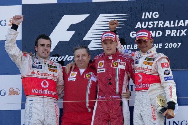 Podium group photo: Fernando Alonso, 2nd position, Ferrari team boss Jean Todt, winner Kimi Räikkönen and Lewis Hamilton, 3rd position.