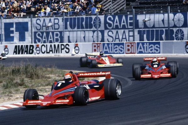 Niki Lauda, Brabham BT46B Alfa Romeo leads team mate John Watson, Brabham BT46B Alfa Romeo and Carlos Reutemann, Ferrari 312T3.