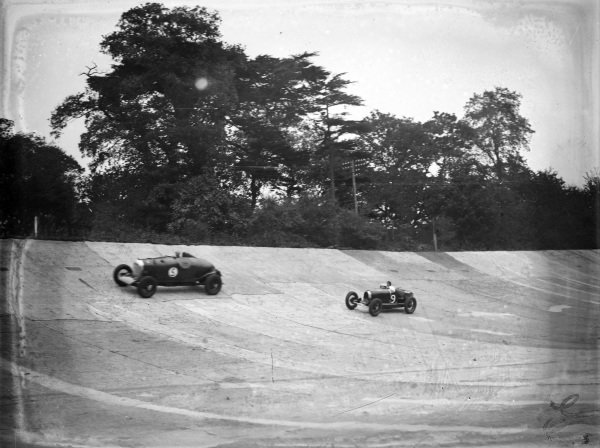 Cars in action on the banking.