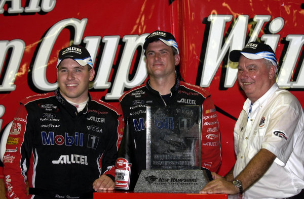 2002 NASCAR,New Hampshire Intl. Speedway,Sept 13-15, 2002 NASCAR, Loudon,NH . USA -Ryan Newman,Matt Borland,Don Miller at the winners podium,Copyright-Robt LeSieur2002LAT Photographic