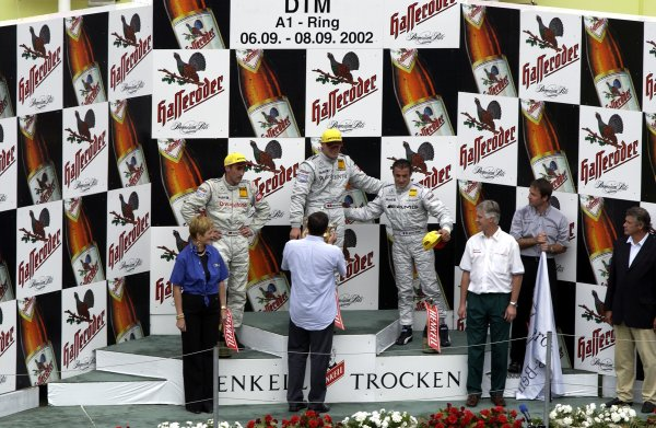 2002 DTM Championship A1 Ring, Austria. 7th - 8th September 2002. Race podium Marcel Fassler 1st, Bernd Schnedier 2nd, and Jean Alesi 3rd.World Copyright: Andre Irlmeier/LAT Photographic