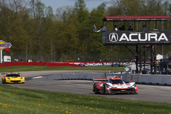 #6 Acura Team Penske Acura DPi, DPi: Juan Pablo Montoya, Dane Cameron crosses the finish line under the checkered flag for the win