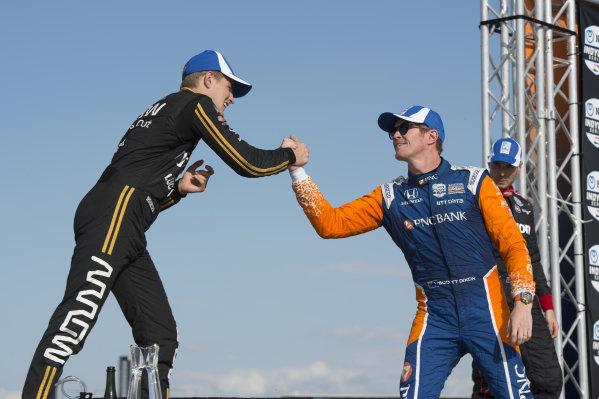 2nd place finnisher Marcus Ericsson, Arrow Schmidt Peterson Motorsports Honda, greets winner Scott Dixon, Chip Ganassi Racing Honda, on the victory podium