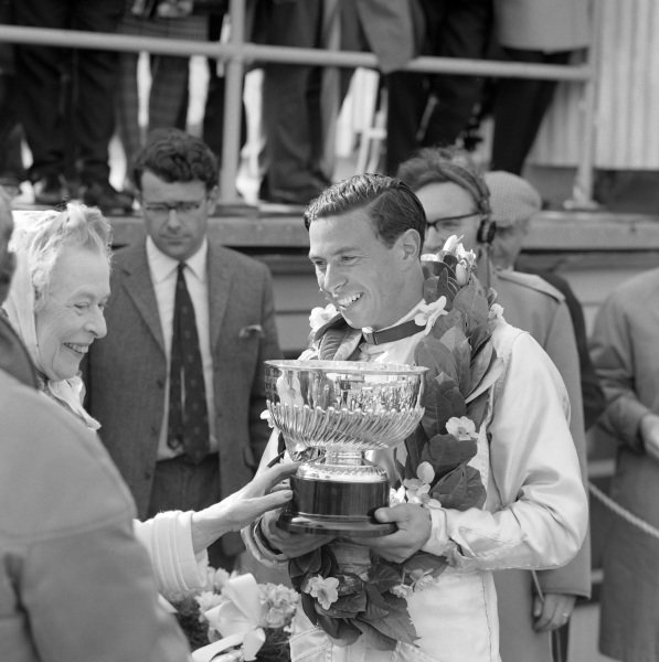 Race winner Jim Clark on the podium.