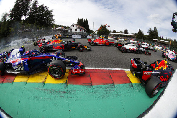 Fernando Alonso, McLaren MCL33, flies over Charles Leclerc, Alfa Romeo Sauber C37, after contact with Nico Hulkenberg, Renault Sport F1 Team R.S. 18. at the start. In the foreground, Max Verstappen, Red Bull Racing RB14, leads Kevin Magnussen, Haas F1 Team VF-18, Kimi Raikkonen, Ferrari SF71H, Daniel Ricciardo, Red Bull Racing RB14, and Pierre Gasly, Toro Rosso STR13.