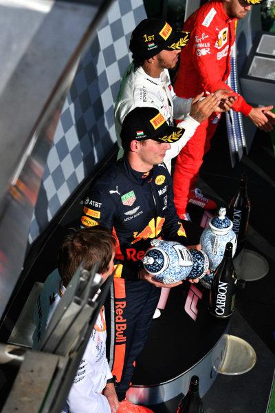 Max Verstappen, Red Bull Racing, 2nd position, with his trophy alongside Lewis Hamilton, Mercedes AMG F1, 1st position, and Sebastian Vettel, Ferrari, 3rd position