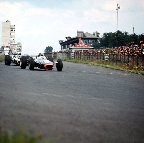 1965 German Grand Prix. Nurburgring, Germany. 1st August 1965. Graham Hill (BRM P261), 2nd position and Jackie Stewart, (BRM P261), retired, action. World Copyright: LAT Photographic Ref-3/1810. World Copyright - LAT Photographic
