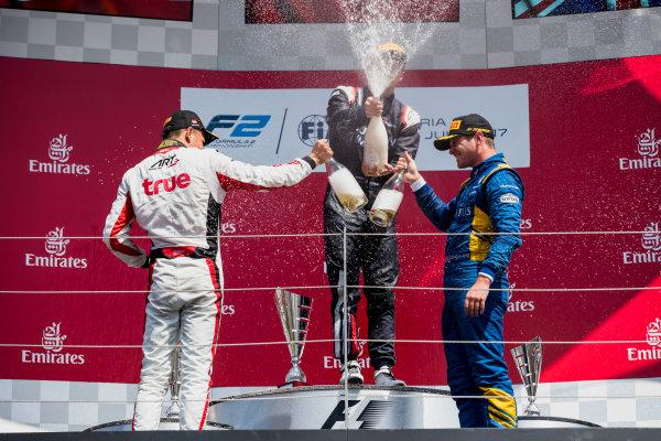 2017 FIA Formula 2 Round 5. Red Bull Ring, Spielberg, Austria. Sunday 9 July 2017. Alexander Albon (THA, ART Grand Prix), Artem Markelov (RUS, RUSSIAN TIME) and Oliver Rowland (GBR, DAMS).  Photo: Zak Mauger/FIA Formula 2. ref: Digital Image _54I0406