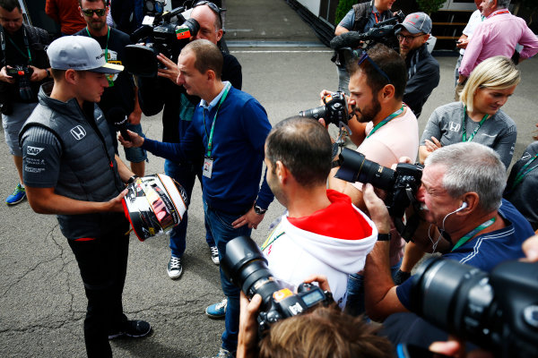 Spa Francorchamps, Belgium.  Thursday 24 August 2017. Stoffel Vandoorne, McLaren, holds a helmet while taking to the media. World Copyright: Andy Hone/LAT Images  ref: Digital Image _ONZ8225