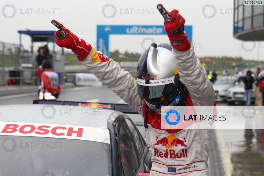 Race winner Mattias Ekstrom (SWE), Audi Sport Team Abt Sportsline, Red Bull Audi A4 DTM (2009) celebrates in parc ferme.DTM, Rd8, Oschersleben, Germany, 16-18 September 2011 Ref: Digital Image dne1118se536