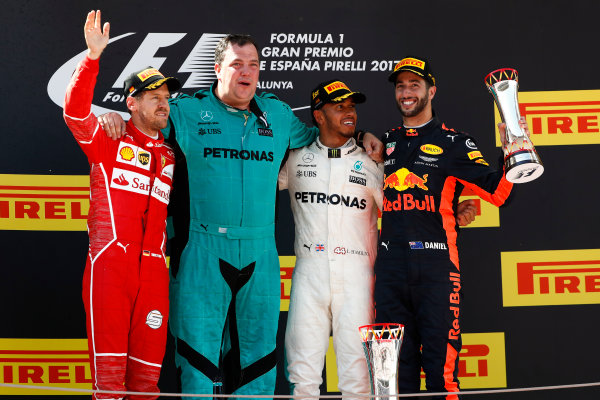 Circuit de Catalunya, Barcelona, Spain. Sunday 14 May 2017. Sebastian Vettel, Ferrari, 2nd Position, Karl Fanson, Mechanic, Mercedes, Lewis Hamilton, Mercedes AMG, 1st Position, and Daniel Ricciardo, Red Bull Racing, 3rd Position, on the podium. World Copyright: Glenn Dunbar/LAT Images ref: Digital Image _X4I9293