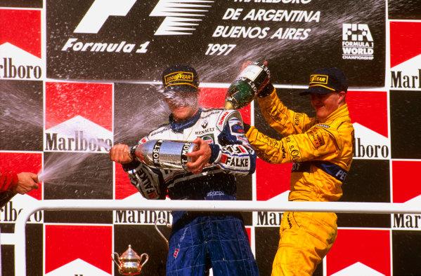 Buenos Aires, Argentina.11-13 APRIL 1997.Jacques Villeneuve (Williams Renault) 1st place, gets sprayed by Ralf Schumacher (Jordan Peugeot) 3rd place, on the podium. Ref-97 ARG 07.World Copyright - LAT Photographic