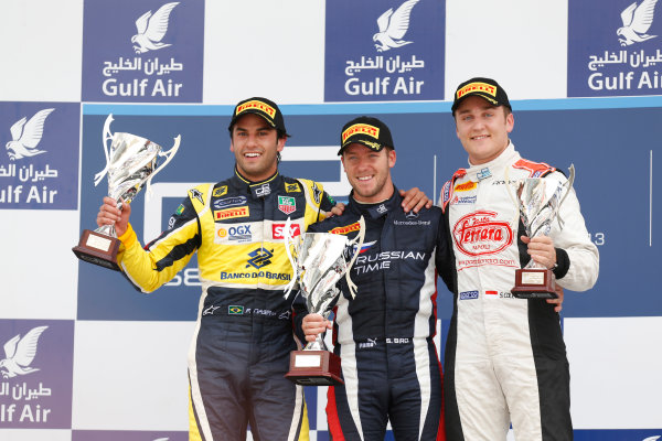 2013 GP2 Series. Round 2.  Bahrain International Circuit, Sakhir, Bahrain. 21st April.  Sunday Race.  Sam Bird (GBR, RUSSIAN TIME) celebrates his victory on the podium with Felipe Nasr (BRA, Carlin) and Stefano Coletti (MON, Rapax). World Copyright: Alastair Staley/GP2 Series Media Service. Ref: _R6T7925